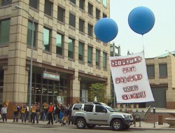 Workers protest at Chipotle (Credit: CBS)