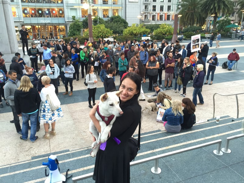 DxE investigator Julianne Perry with rescued dog Lao at the San Francisco 10,000 candles vigil for the Yulin dog meat dogs killed last month. Photo by Michael Goldberg.